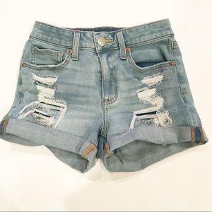Aero High Rise Midi Distressed Denim Shorts